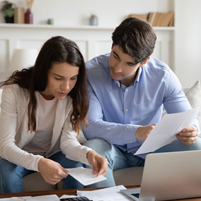 Couple preparing for mortgage underwriting process