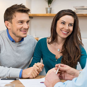 couple speaking with closing agent during closing process