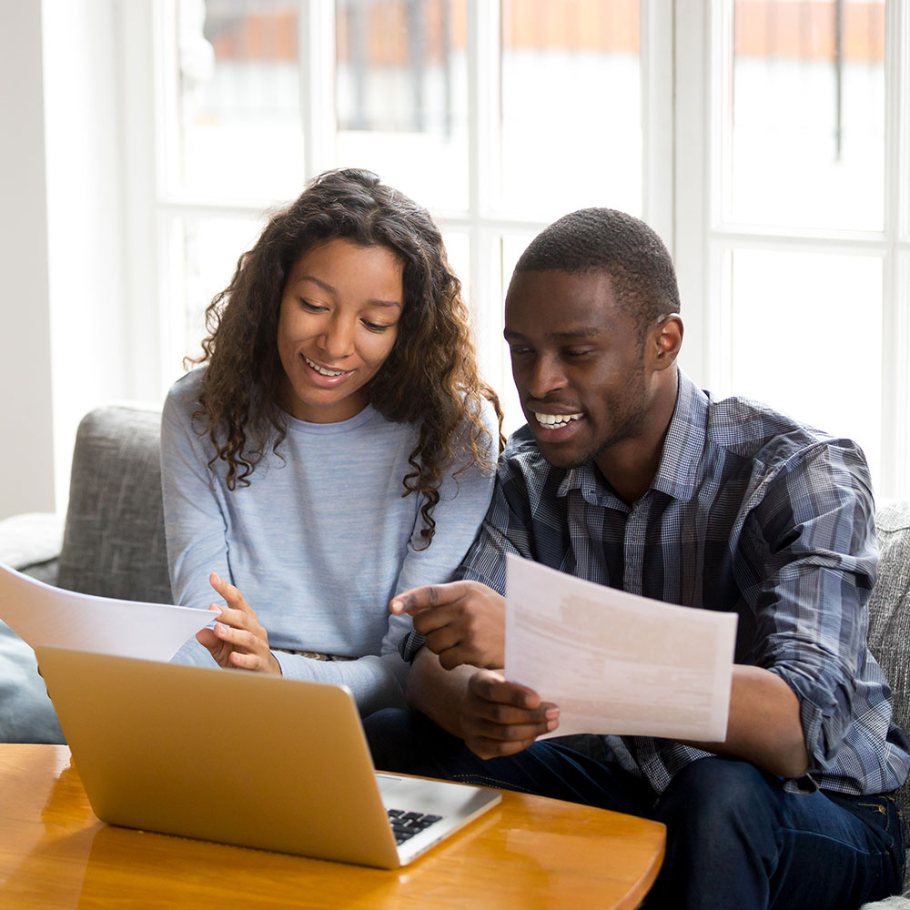 couple reviewing conventional mortgage pros and cons