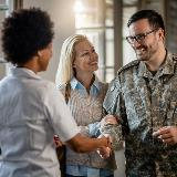 mortgage lender shaking veteran's hand after he secures a VA loan
