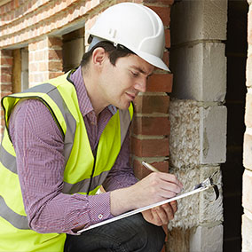 home inspector inspecting a home
