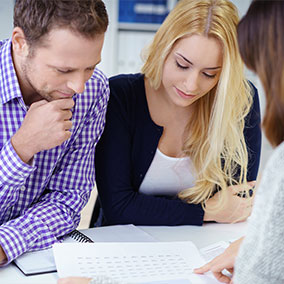 man and woman reviewing mortgage insurance documents