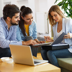 Couple reviewing mortgage process with loan officer