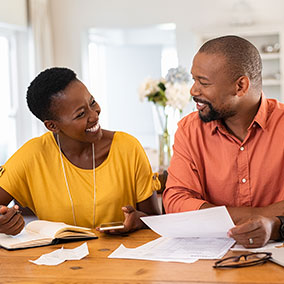 Man and woman reviewing mortgage paperwork