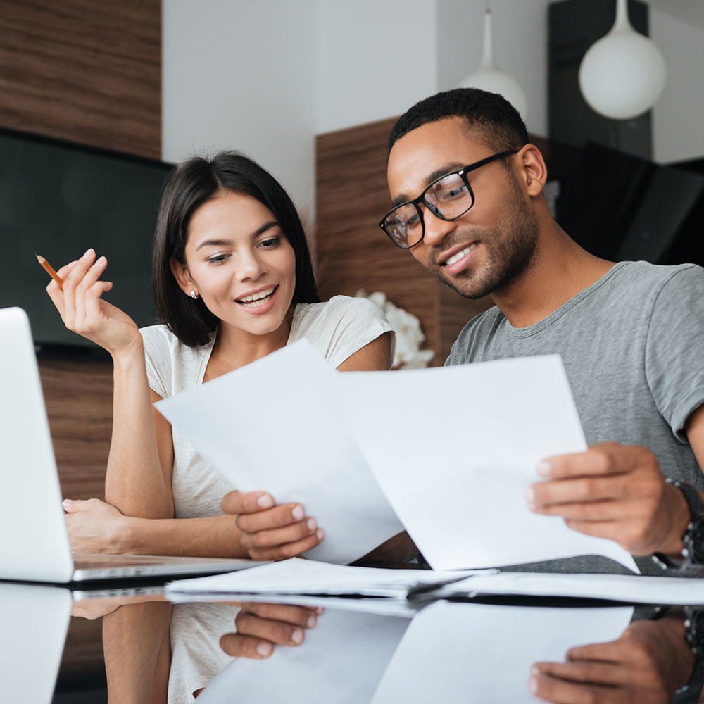 couple reviewing mortgage amortization schedules